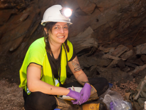 Caitlin Casar, a Ph.D. candidate at Northwestern University, studies microbes living deep beneath the Earth's surface in the Deep Mine Microbial Observatory, an old gold mine in Lead, South Dakota. (Photo credit: Matthew Kapust/Sanford Underground Research Facility)